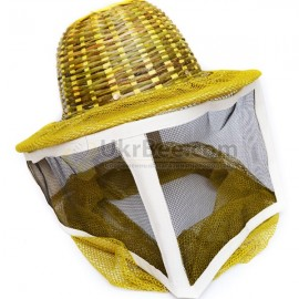 Mask of a beekeeper with a metal mesh, a hat of bamboo