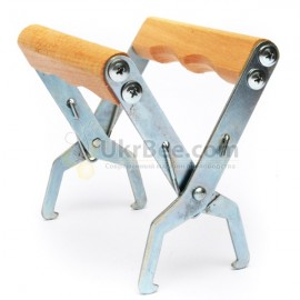 The grip for frames with wooden handles