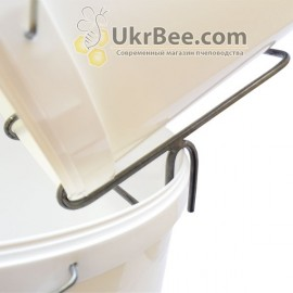 Bucket holder with honey,